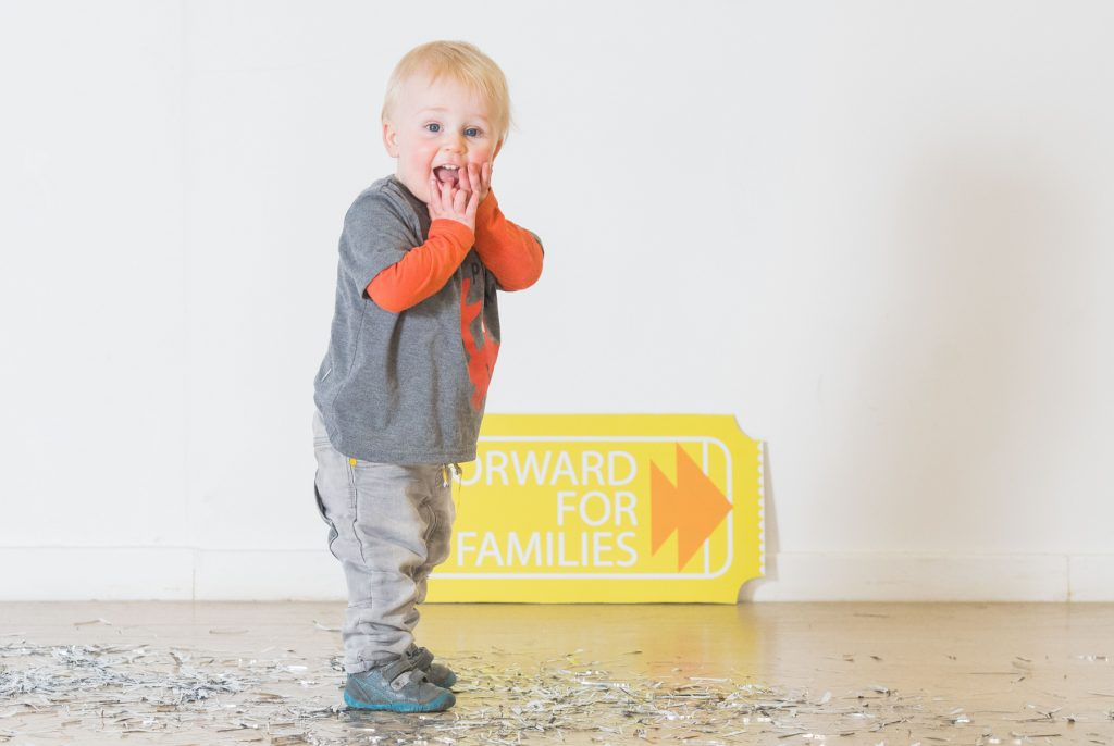 """WWW.IANGEORGESONPHOTOGRAPHY.CO.UK Picture: Finn McDougall 16months with a giant ticket Just the Ticket for Scotland's Toddlers Starcatchers Scotland's National Arts and Early Years Organisation has launched a new fundraising scheme, Forward for Families, to provide theatre seats for very young children and their families in need across Scotland. A recent study suggests more than 200,000 children are growing up in poverty in Scotland. Scottish Government Social Research consistently evidences that access to theatre and cultural experience enriches lives and impacts positively on health and well-being. However a Starcatchers audit of audience participation suggests 72% rarely engage in cultural experiences with their babies and many have never engaged with their local community arts venue. Forward for Families will enable parents with very young children from all walks of life in Scotland to experience a high-quality shared theatre experience. Seats will be allocated within the Scottish tour of Starcatchers and Edinburgh based dance company Curious Seed's new dance, live music and theatre experience MamaBabaMe, for babies aged 18 months – 3 years and their parents and carers. Working in partnership with three venues in Scotland; The Byre Theatre in St Andrews, Platform in Easterhouse, Glasgow and Macrobert Arts Centre in Stirling, the scheme has an initial fundraising target of £800 and will directly benefit 45 families across these three communities. Scottish children's theatre is celebrated across the world as being some of the most creative and innovative. Starcatchers has seen growth, appreciation and demand for their work rapidly increase as parents, carers and educators see the value that creativity and the arts has on young children. Rhona Matheson, Chief Executive of Starcatchers said: """"Babies and the adults who care for them are at the heart of everything that we do at Starcatchers. We believe that arts and creativity has the power to transform lives and ther"""