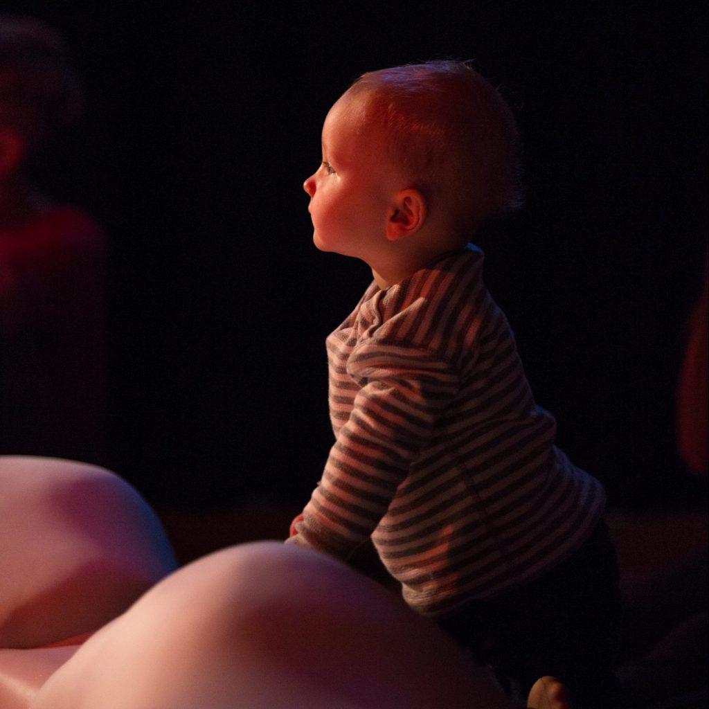 A baby against a dark background