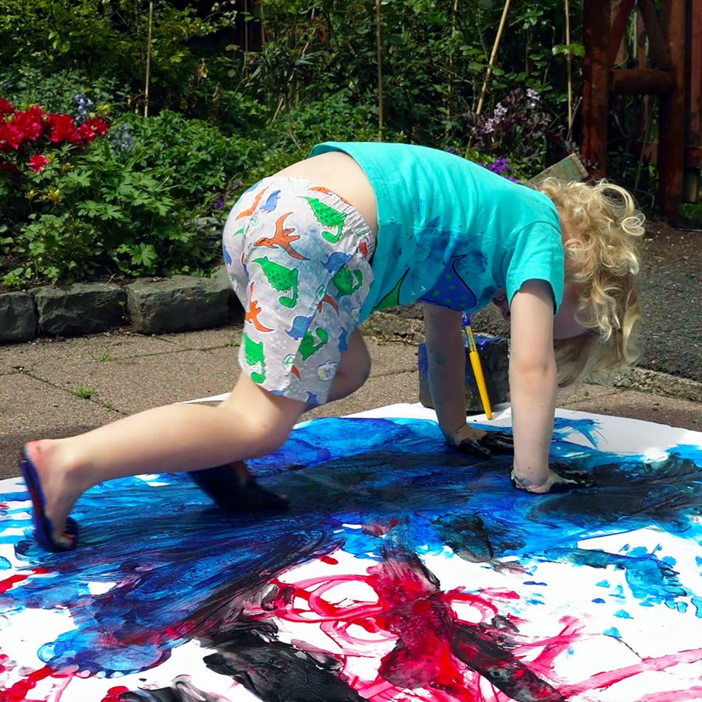 Child exploring paint